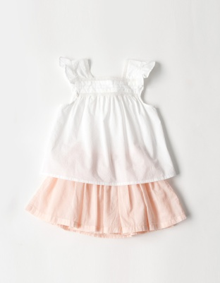 BONTON_白のノースリーブブラウスとオレンジのスカート